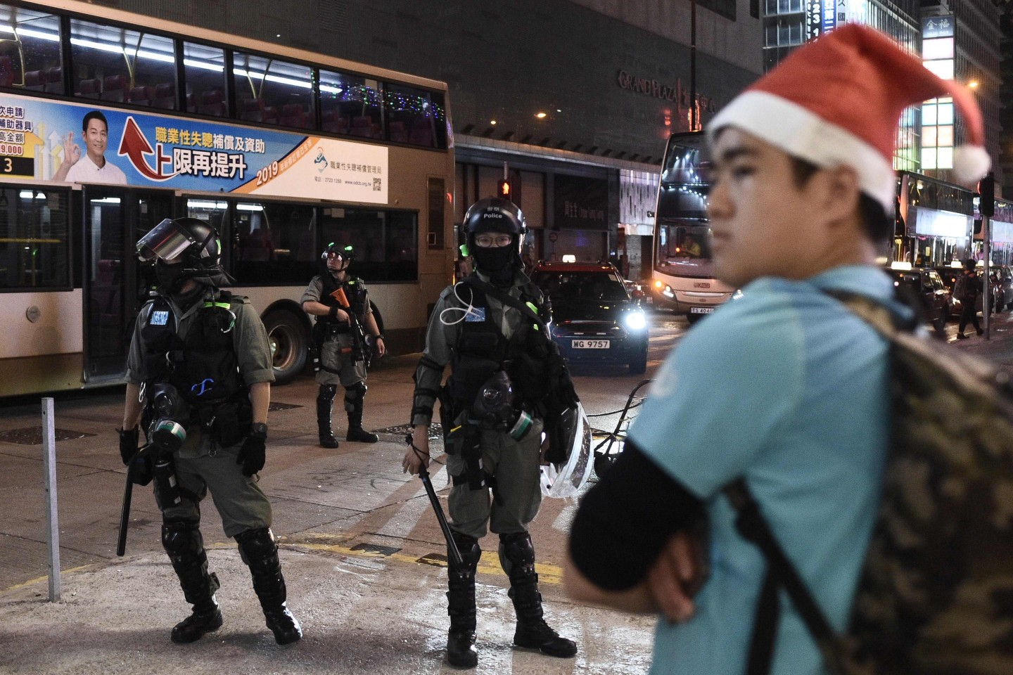 "Hong Kong's Christmas celebrations were marred by sporadic clashes between police and pro-democracy activists on 25 December 2019 as the city's pro-Beijing leader said the festive season was being ""ruined"" by demonstrators. (Philip Fong/AFP)"