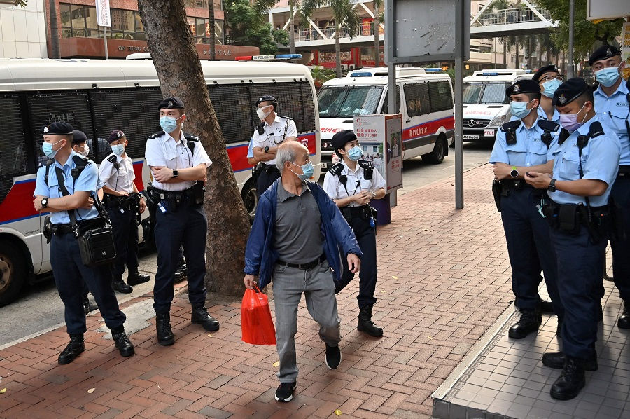 Police gather as the League of Social Democrats prepare to hold a protest against Beijing's plan to change Hong Kong's electoral system in Hong Kong on 17 March 2021. (Peter Parks/AFP)