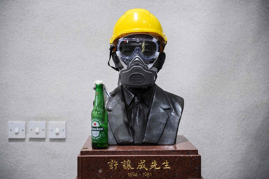 Yellow helmut, goggles and bust of business tycoon