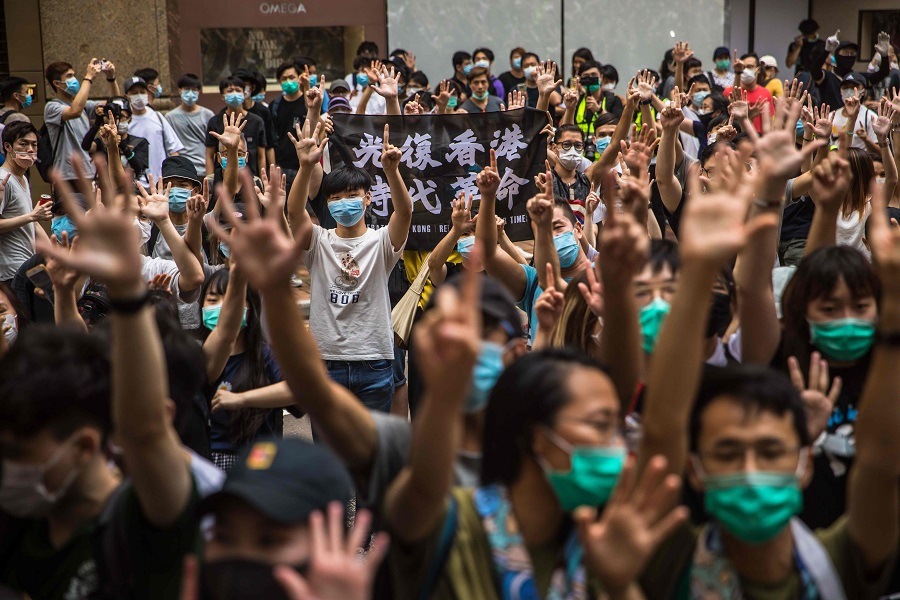 Protesters chant slogans during a rally against a new national security law in Hong Kong on 1 July 2020, on the 23rd anniversary of the city's handover from Britain to China. (Dale De La Rey/AFP)