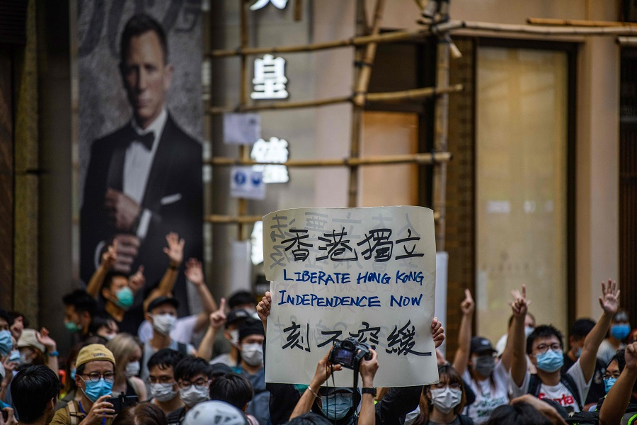 Protesters chant slogans and hold a placard during a rally against a new national security law in Hong Kong on 1 July 2020. (Anthony Wallace/AFP)