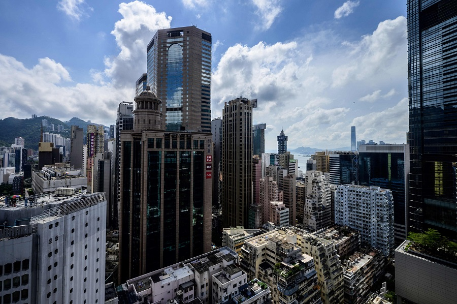 This general view shows residential and commercial buildings in the Causeway Bay district of Hong Kong Island in Hong Kong, China, on 14 May 2021. (Anthony Wallace/AFP)