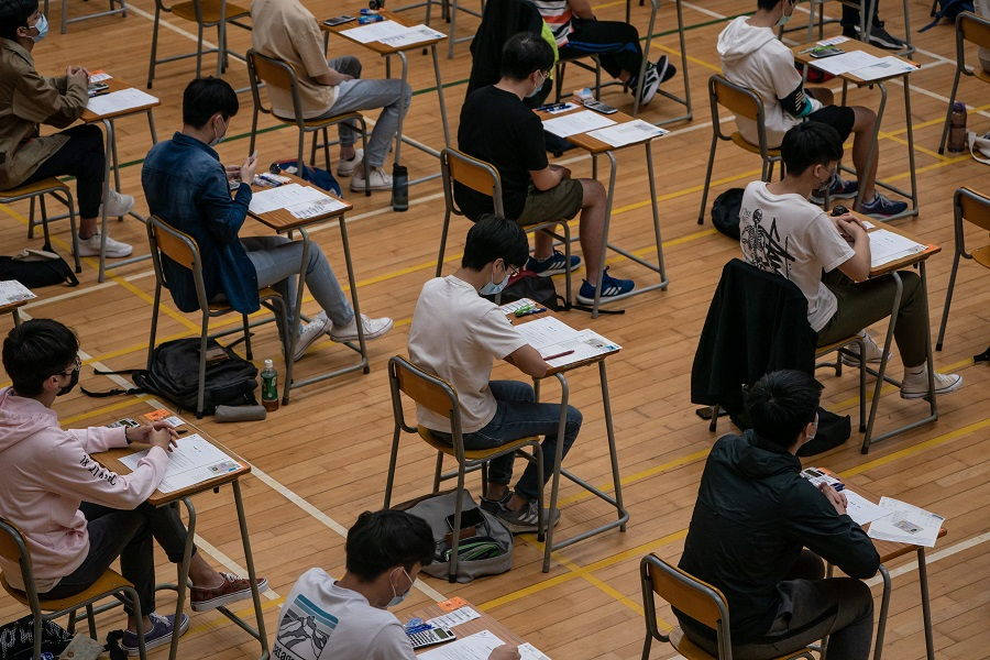 Secondary school students sit for the diploma of secondary education (DSE) exams in Hong Kong on 26 April 2021. (Anthony Kwan/Pool/AFP)