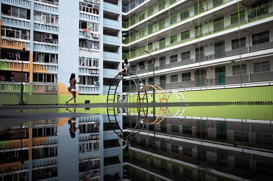 People take photos at a playground in a public housing estate in Hong Kong on 29 August 2021. (Bertha Wang/AFP)