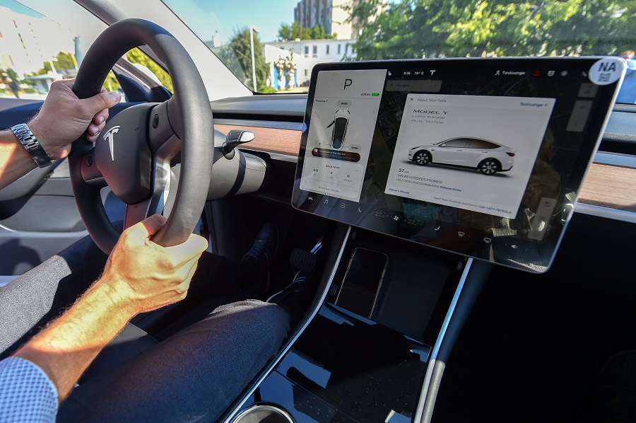 "A picture taken on 5 September 2020 shows an inside view of a ""Tesla Model Y"" car, an all-electric compact SUV by US electric car giant Tesla, during its presentation at the Automobile Club in Budapest. (Attila Kisbenedek/AFP)"