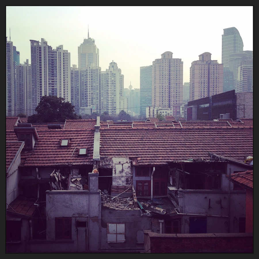 The contrast between the old dwellings in the Zhabei district with the modern blocks in the background.
