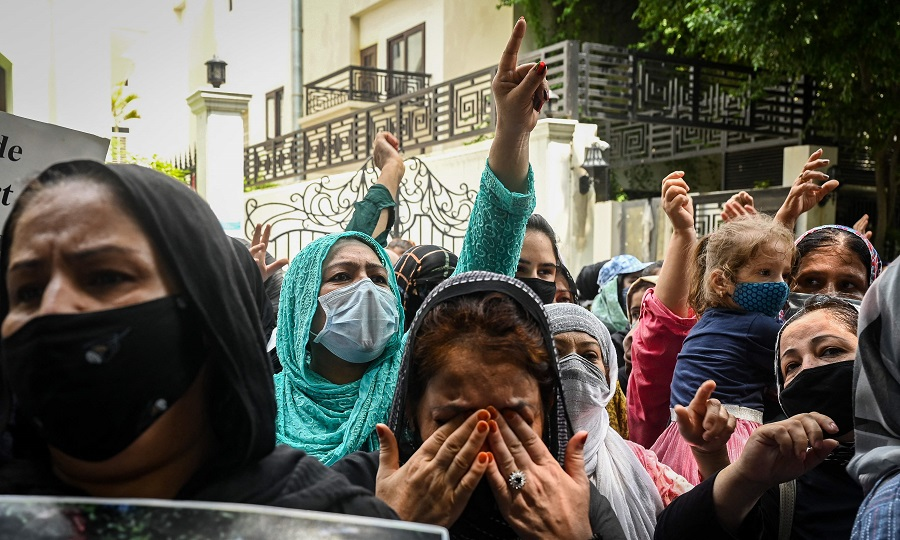 Afghans residing in India take part in a demonstration outside the United Nations High Commissioner for Refugees (UNHCR) office in New Delhi, India on 23 August 2021 to protest against the Taliban's military takeover of Afghanistan. (Sajjad Hussain/AFP)