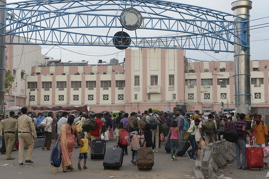 People wait outside a railway station to return home during a lockdown imposed to curb the spread of the Covid-19 coronavirus, in Secunderabad the twin city of Hyderabad, India, 31 May 2021. (Noah Seelam/AFP)