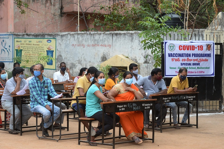 People wait to receive a dose of the Covishield vaccine against the Covid-19 coronavirus in Hyderabad, India, on 28 May 2021. (Noah Seelam/AFP)
