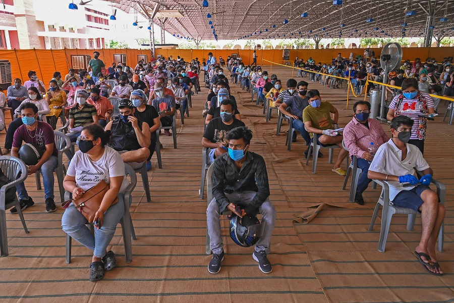 People wait to get a dose of the Covishield vaccine against the Covid-19 coronavirus at the vaccination centre of BLK-Max hospital in New Delhi, India, on 4 May 2021. (Prakash Singh/AFP)