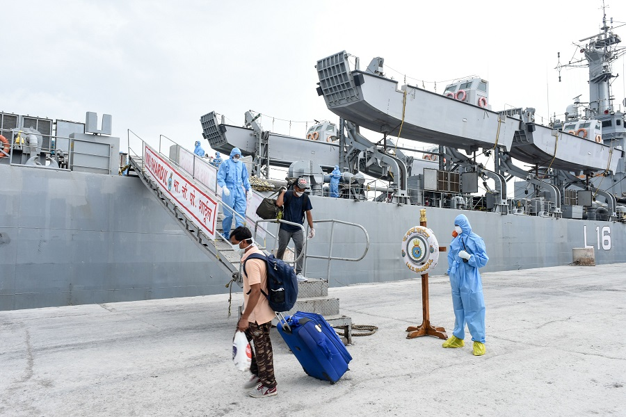 In this handout photograph taken by the Indian Press Information Bureau (PIB), Defence Wing, and released on 11 June 2020, Indian nationals previously stranded in Iran arrive with the Indian Naval Ship (INS) Shardul at Porbandar, some 400 kms from Ahmedabad, as part of a repatriation effort due to the Covid-19 coronavirus. (Handout/PIB Defence Wing/AFP)