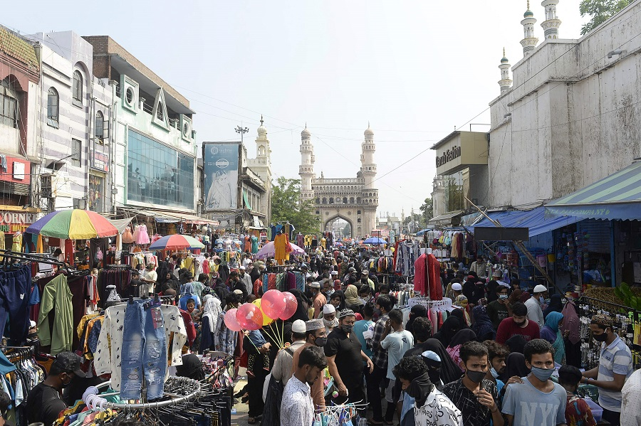People gather at a market during relaxation for all activities on the occasion of Eid al-Fitr, in front of historical monument Charminar in the old city of Hyderabad, India, on 13 May 2021. (Noah Seelam/AFP)