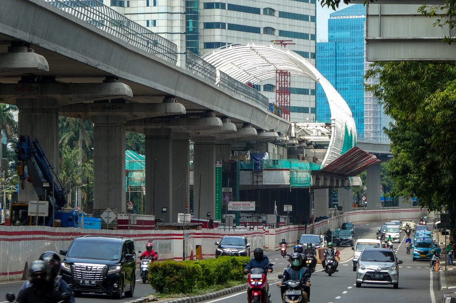 Motorists drive under an unfinished light rapid transit terminal construction in Jakarta on 27 May 2020. (Bay Ismoyo/AFP)