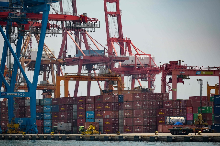 Stacks of containers are seen at the Port of Tanjung Priok in Jakarta, Indonesia, on 31 March 2021. (Bay Ismoyo/AFP)