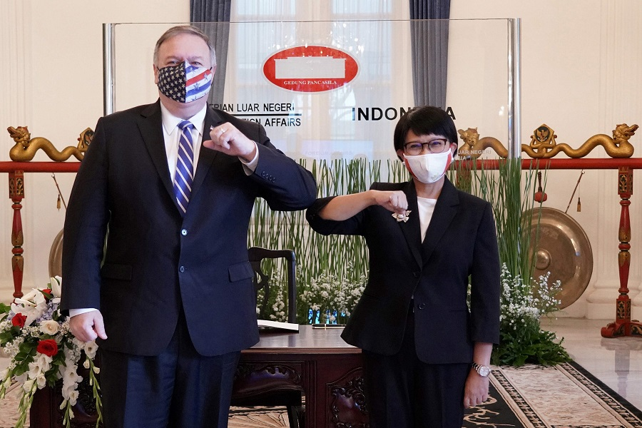 This handout photograph taken and released on 29 October 2020 by the Indonesian Foreign Ministry shows US Secretary of State Michael Pompeo (left) posing with Indonesian Foreign Minister Retno Marsudi during their meeting in Jakarta. (Handout/Indonesian Foreign Ministry/AFP)