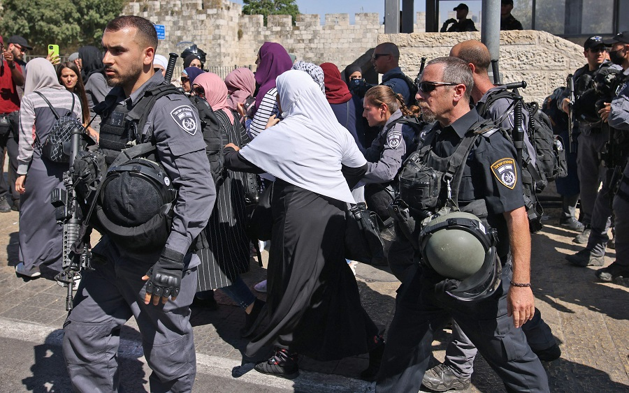 Israeli security forces disperse Palestinian protesters outside the Damascus gate in east Jerusalem, on 15 June 2021, ahead of the March of the Flags which celebrates the anniversary of Israel's 1967 occupation of the city's eastern sector. (Ahmad Gharabli/AFP)