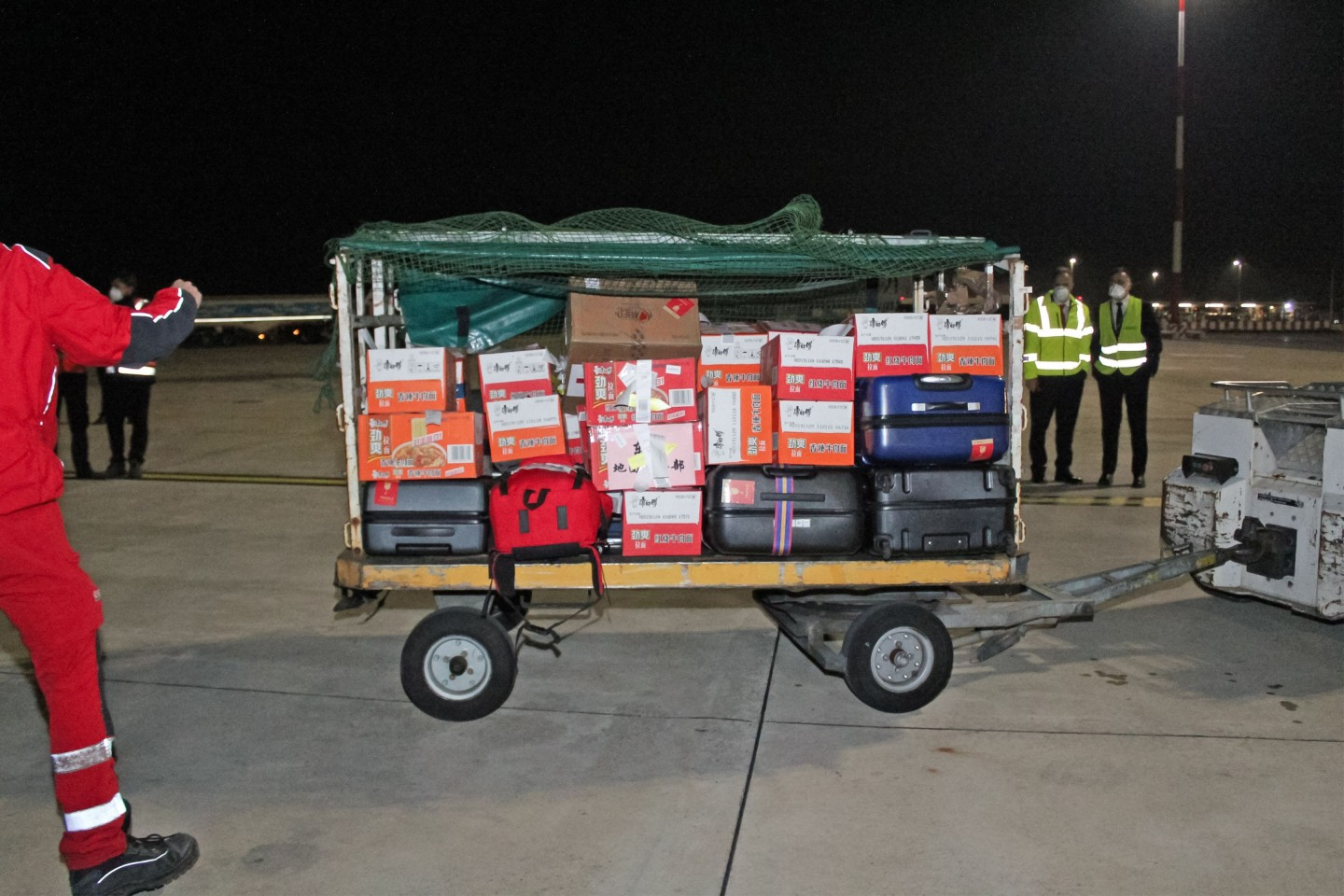 This photo provided by Italian news agency Ansa on 13 March 2020 shows supplies being unloaded after a China Eastern flight bringing medical supply from China landed on 13 March at Rome's Fiumicino international airport from Shanghai, to help fight the new coronavirus in Italy. (STRINGER/ANSA/AFP)
