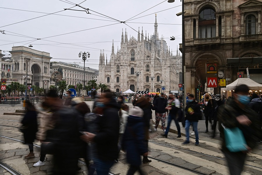 People walk by Duomo square in downtown Milan, Italy, on 6 February 2021. (Miguel Medina/AFP)