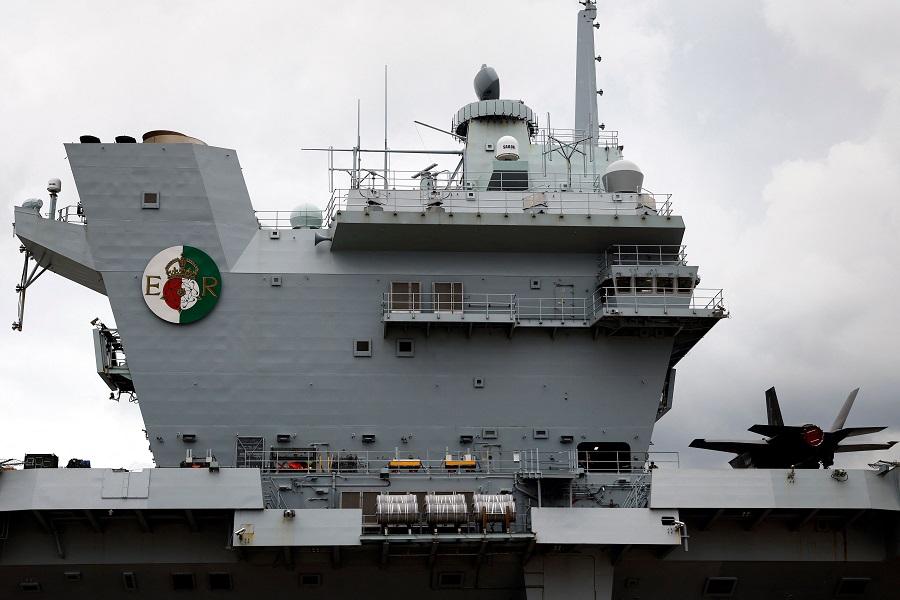 The British Royal Navy's HMS Queen Elizabeth aircraft carrier sits anchored at the US naval base in Yokosuka, Kanagawa Prefecture on 6 September 2021. (Kiyoshi Ota/AFP)