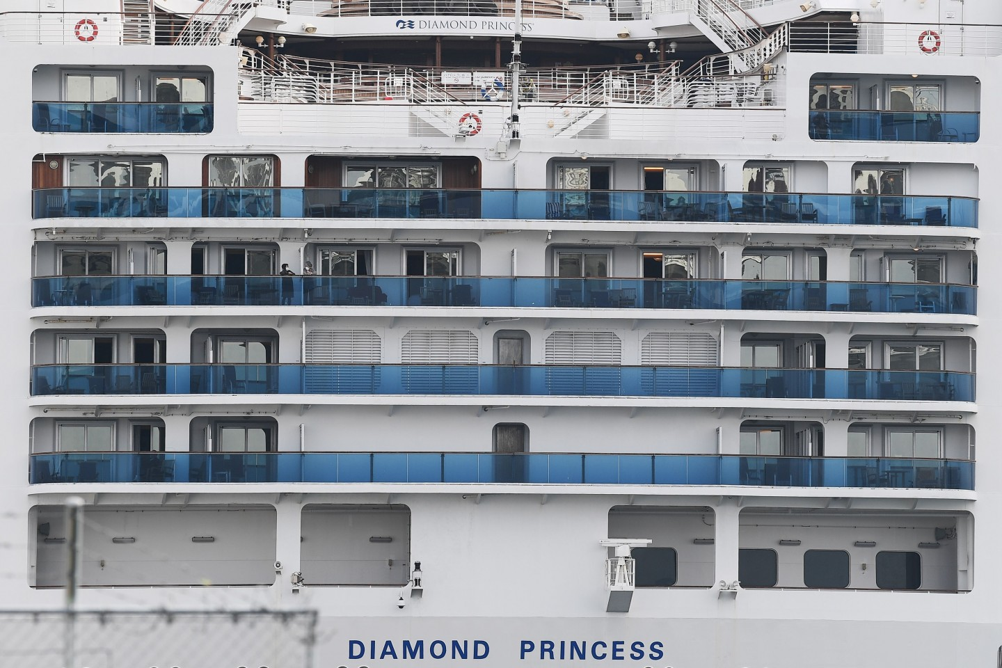 The Diamond Princess cruise ship, with around 3,600 people quarantined onboard due to fears of Covid-19, is seen at the Daikoku Pier Cruise Terminal in Yokohama port on 14 February 2020. (Charly Triballeau/AFP)