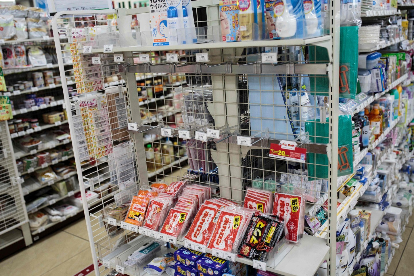 The picture shows empty shelves for face masks in a convenience store in Tokyo on 3 February 2020. (Behrouz Mehri/AFP)