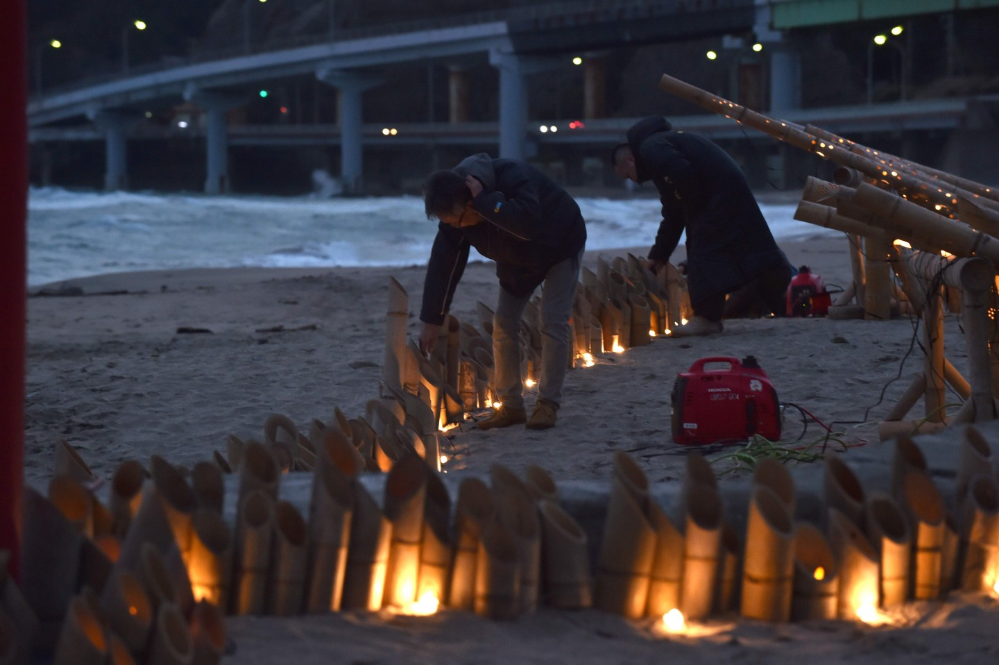 Local volunteers prepare a candle service for people who have just returned from Wuhan and are quarantined in a hotel in Katsuura, Chiba Prefecture, on 12 February 2020. (Kazuhiro Nogi/AFP)