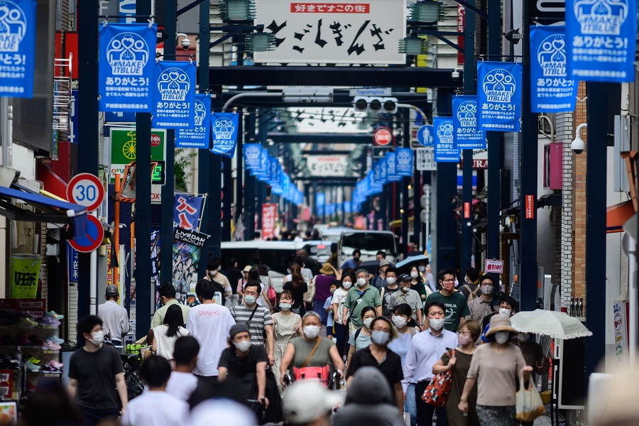 People wearing face masks as a preventive measure against the Covid-19 coronavirus visit Togoshi Ginza shopping street in Tokyo on 1 August 2020. (Philip Fong/AFP)