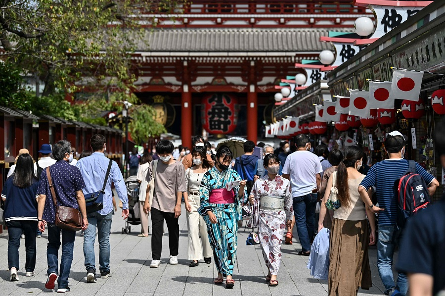 People visit Sensoji temple in Tokyo's Asakusa district on 22 September 2020. (Charly Triballeau/AFP)