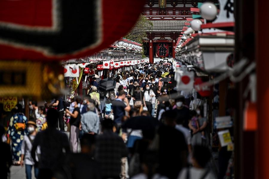 People visit Sensoji temple in Tokyo's Asakusa district on 22 September 2020. (Charly Triballeau/AFP)