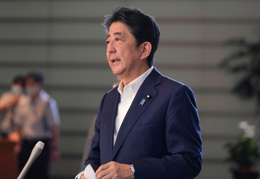 Japan Prime Minister Shinzo Abe speaks to the media upon his arrival at the prime minister's office in Tokyo on 19 August 2020. (Kazuhiro Nogi/AFP)