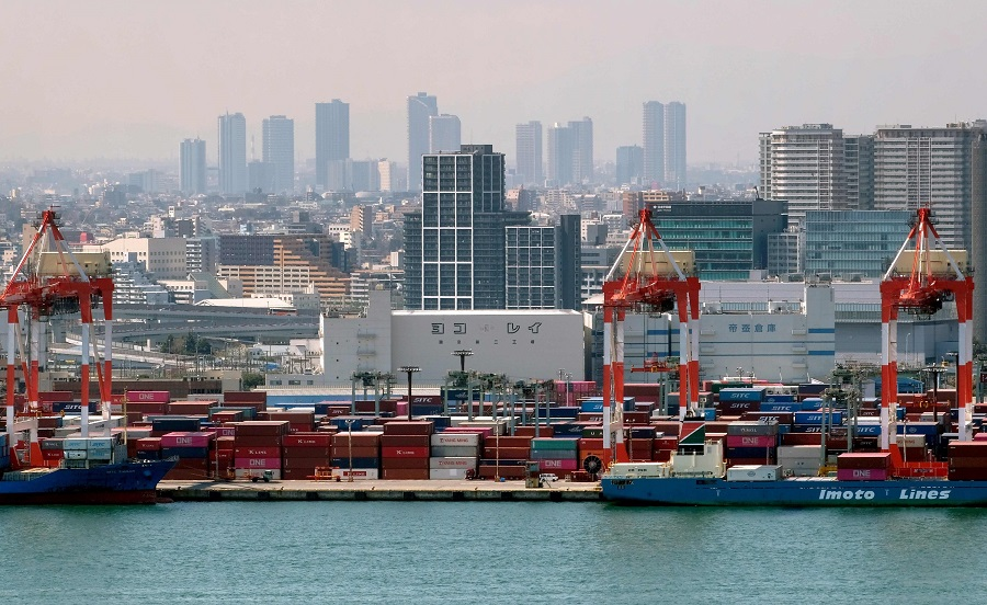 Containers are seen at the international cargo terminal at the port of Tokyo on 18 March 2020. (Kazuhiro Nogi/AFP)