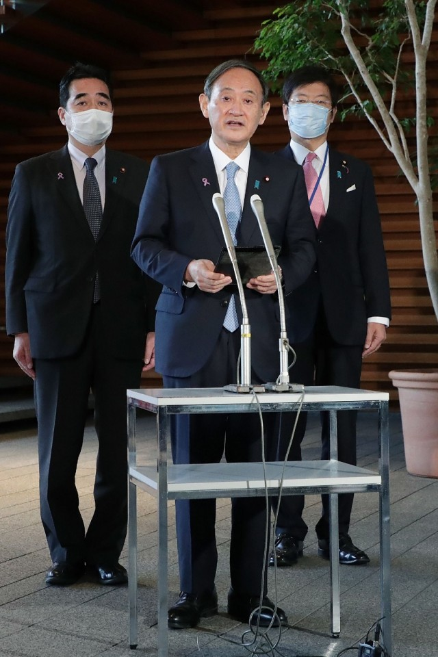 apanese Prime Minister Yoshihide Suga speaks to the reporters after his telephone talk with US President-elect Joe Biden, at the prime minister's official residence in Tokyo on 12 November 2020. (STR/Jiji Press/AFP)