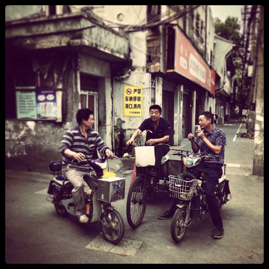 Impromptu catchup of friends at an intersection of a former neighbourhood in Yangpu district.