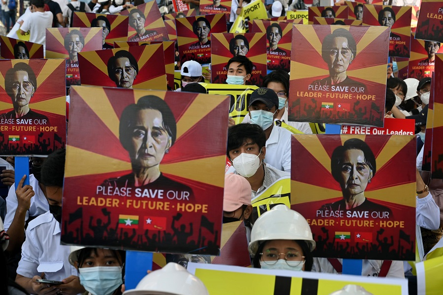 Protesters hold signs calling for the release of detained Myanmar civilian leader Aung San Suu Kyi at a demonstration against the military coup in Yangon, Myanmar, on 14 February 2021. (Sai Aung Main/AFP)