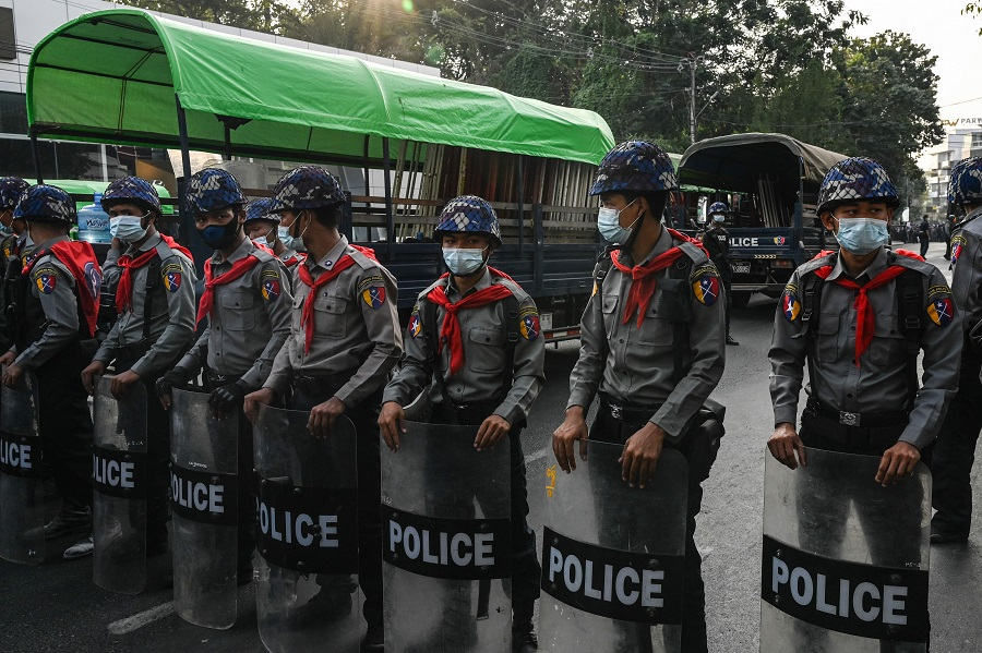 Police block the street leading to the headquarters of the National League for Democracy (NLD) in Yangon, Myanmar, on 15 February 2021, after the military seized power in a coup two weeks ago. (Ye Aung Thu/AFP)