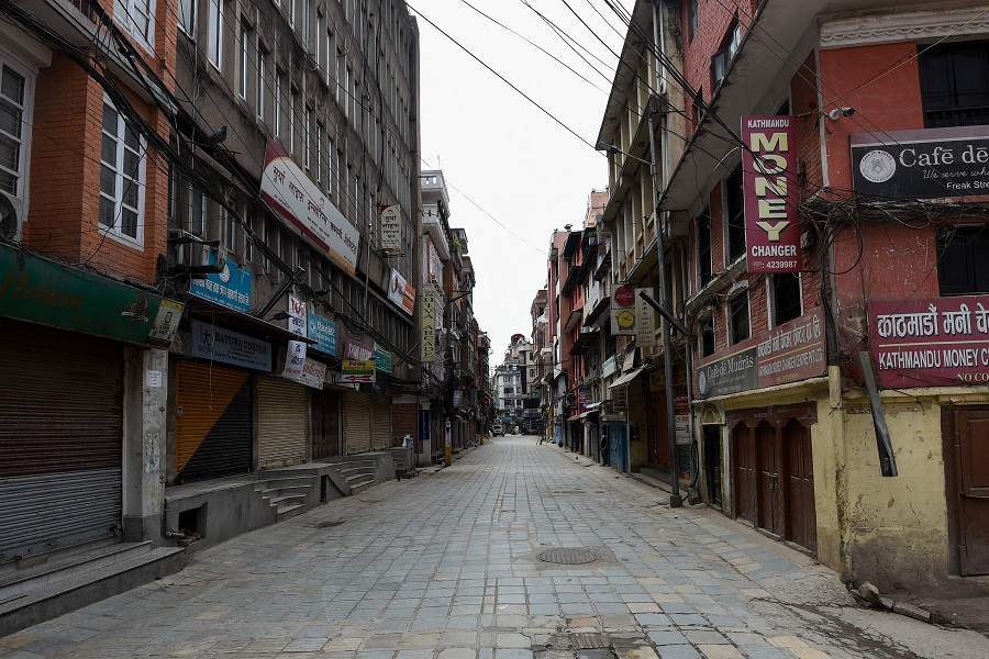 This photo taken on 16 April 2020 shows a deserted street during a government-imposed nationwide lockdown as a preventive measure against the Covid-19 coronavirus in Kathmandu, Nepal. (Prakash Mathema/AFP)