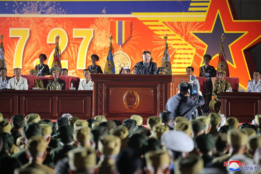 This picture taken on 27 July 2021 and released from North Korea's official Korean Central News Agency (KCNA) on 28 July 2021 shows North Korean leader Kim Jong-un making a speech in front of the Monument to the Victorious Fatherland Liberation War in Pyongyang to mark the 68th anniversary of the Korean War Armistice. (STR/KCNA VIA KNS/AFP)
