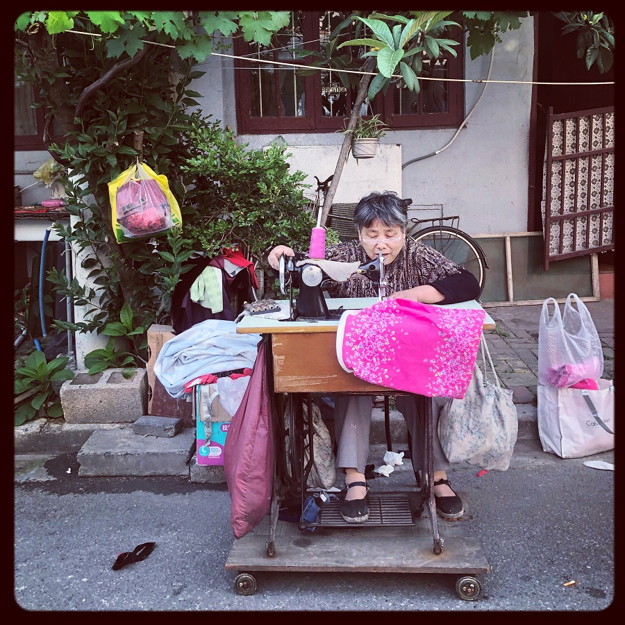 A typical presence in old neighborhoods, this seamstress in Yangpu, Shanghai is hard at work fixing many people's fabric-related problems.