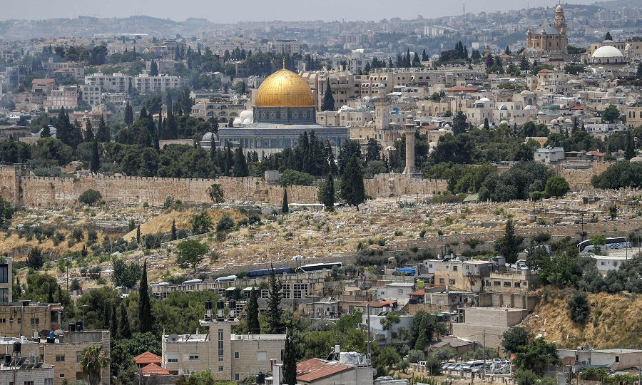 This picture taken on 3 June 2020 shows a view of the Palestinian neighbourhood of Wadi al-Joz (below) in occupied east Jerusalem, with a backdrop of the Dome of the Rock Mosque in Jerusalem's old city. (Ahmad Gharabli/AFP)