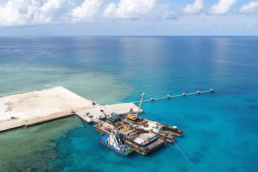 This handout photo received on 9 June 2020 from the Department National Defense Philippines (DND), shows an aerial shot of the newly constructed beach ramp at Philippine-held Pag-asa Island also known as Thitu Island in the Spratly archipelagos during a visit of Philippine Secretary of national Defense Delfin Lorenzana. (Handout/Department National Defense Philippines (DND)/AFP)