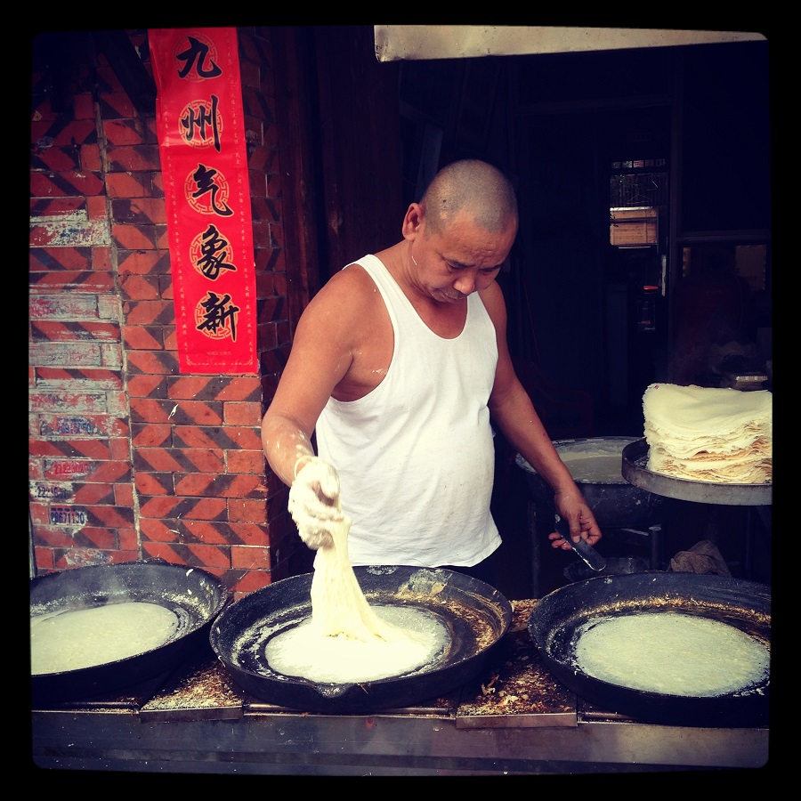 This street side pancake maker is busy at work preparing batches of the local variety consumed in Quanzhou, Fujian known as runbing (润饼).