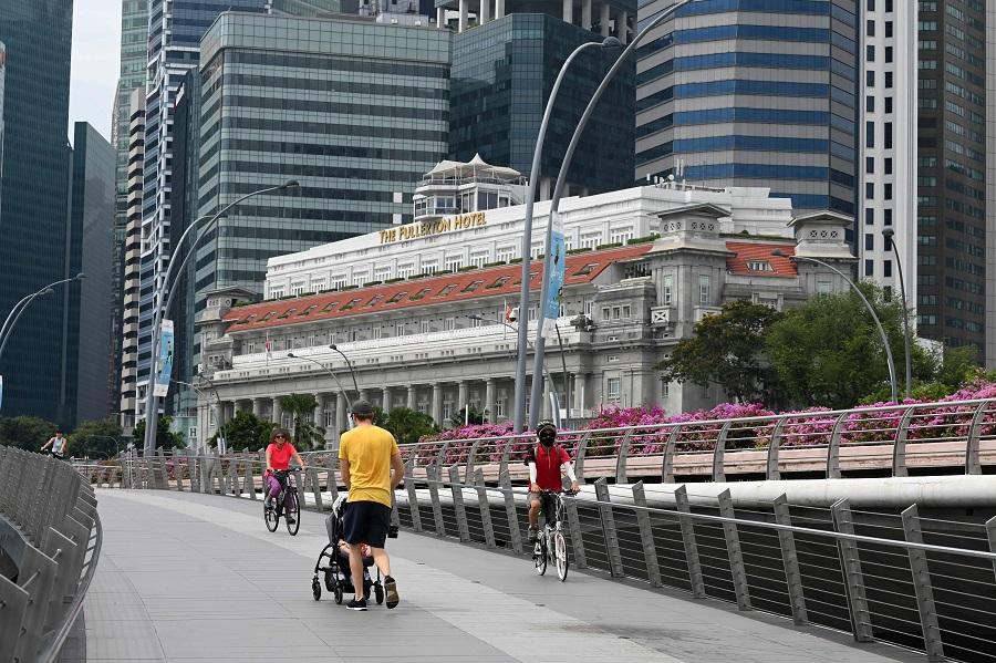 People stroll along Marina Bay in Singapore on 14 October 2020. (Roslan Rahman/AFP)