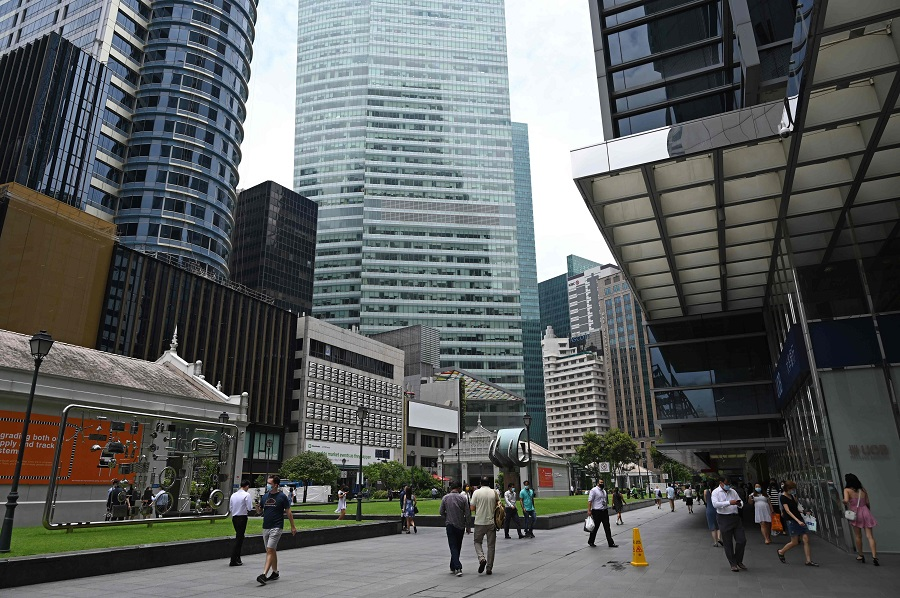 People walk along Raffles Place (Central Business District) in Singapore on 15 September 2020. (Roslan Rahman/AFP)