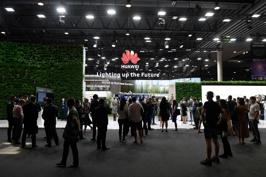 People visit the Huawei stand at the Mobile World Congress (MWC) fair in Barcelona, Spain, on 29 June 2021. (Josep Lago/AFP)