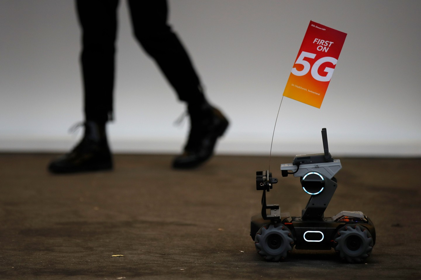 A 5G flag carried by a robot is pictured during the 10th Global mobile broadband forum hosted by Huawei in Zurich on October 15, 2019. - Chinese telecom giant Huawei announced on October 16, 2019 that it has passed the 400,000 5G antennas mark, the fifth generation of mobile phones, in the world with 56 operators who have already started to roll out the new mobile network. (Photo by STEFAN WERMUTH / AFP)