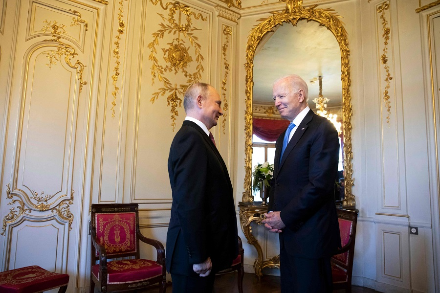 US President Joe Biden (right) talks to Russian President Vladimir Putin prior to the US-Russia summit at the Villa La Grange, in Geneva, Switzerland, on 16 June 2021. (Peter Klaunzer/Pool/AFP)