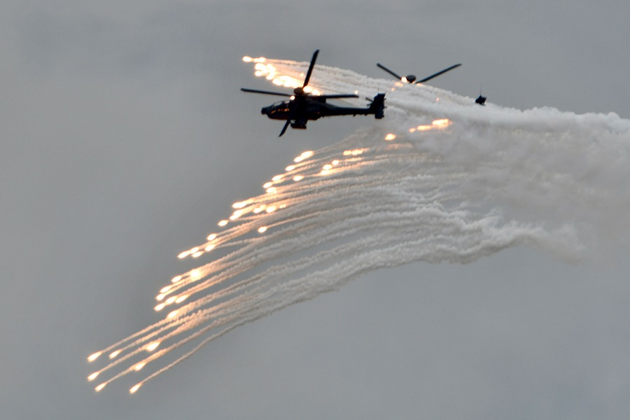 Two US-made AH-64E Apache attack helicopters release flares during the annual Han Kuang military drills in Taichung on 16 July 2020. (Sam Yeh/AFP)