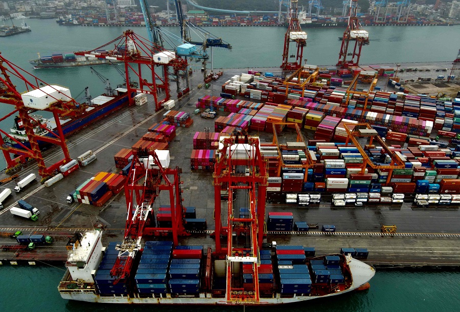 This aerial photograph taken on 8 December 2020 shows a cargo ship (bottom) being loaded with containers at the harbour in Keelung, Taiwan. (Sam Yeh/AFP)
