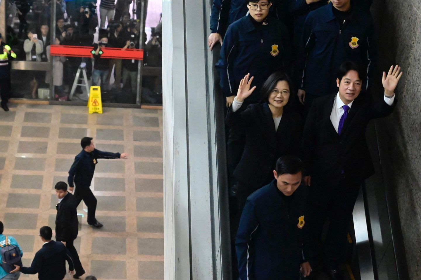 Taiwan's President Tsai Ing-wen (center) and former premier William Lai (centre right) wave after registering as presidential and vice presidential candidates in the upcoming election at the Central Elections Committee in Taipei on November 19, 2019. (Sam Yeh/AFP)