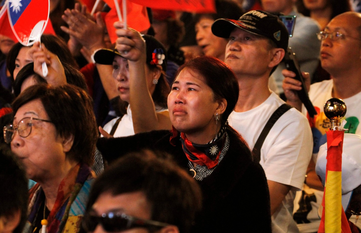 Supporters of Han Kuo-Yu, presidential candidate for Taiwan's main opposition Kuomintang (KMT) party, react as he conceded defeat in the presidential polls during a rally outside the party headquarters in Kaohsiung on 11 January 11 2020. (Hsu Tsun-hsu/AFP)